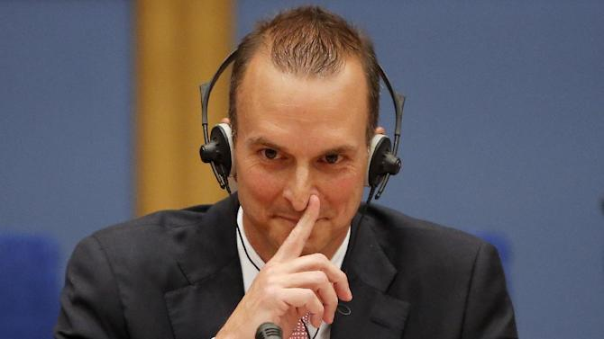 The head of the U.S. Anti-Doping Agency (USADA), Travis Tygart gestures as he speaks before a senate-led inquiry into the fight against doping in Paris, France, Thursday, April 25, 2013. The hearings are aimed at looking into ways of improving the fight against doping. USADA'S report produced a scathing report detailing systematic doping by Lance Armstrong and his teams, which led to Armstrong being stripped of his seven Tour titles and banned from elite sport for life. (AP Photo/Francois Mori)