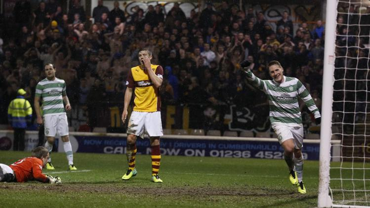 Celtic's Kris Commons celebrates his second goal against Motherwell during their Scottish Premier League soccer match