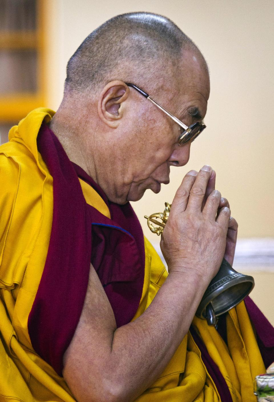 Tibetan spiritual leader the Dalai Lama prays during a prayer session in Dharmsala, India, Monday, Sept. 26, 2011. (AP Photo/Ashwini Bhatia)