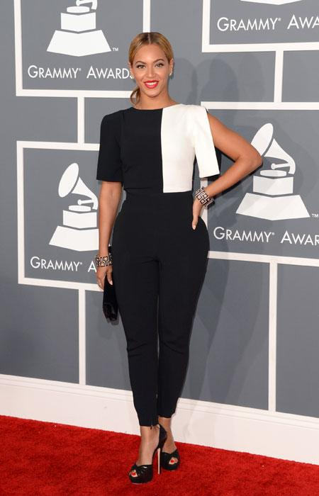 It seems that Beyoncé is taking the infamous Grammy memo to heart. The sexy Superbowl halftime singer surprises everyone by covering up her curves in a black and white colour block pantsuit. We hope this become a new trend!  (Photo by Jason Merritt/Getty Images)