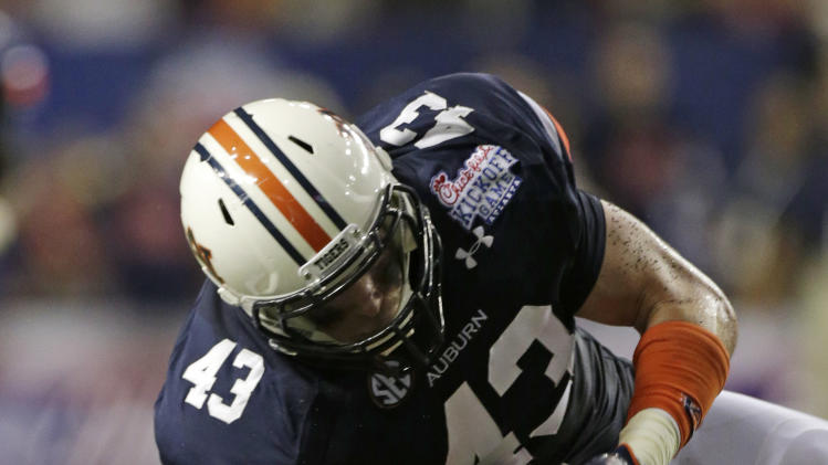 Auburn tight end Philip Lutzenkirchen (43) is stopped after a pass reception by Clemson defensive back Xavier Brewer (9) in the second quarter of a NCAA college football game at the Georgia Dome in Atlanta Saturday, Sept. 1, 2012. (AP Photo/Dave Martin)