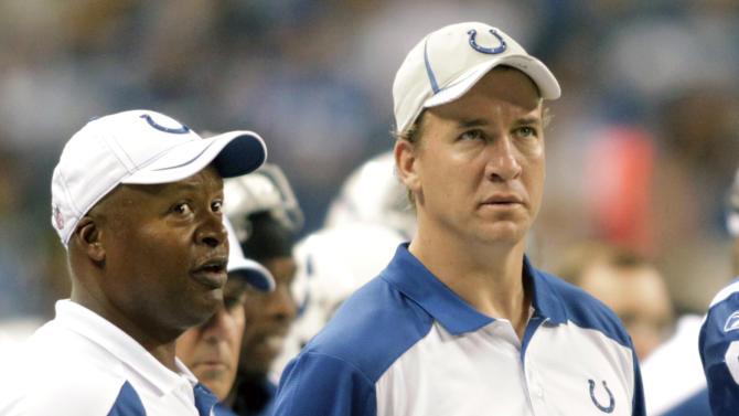 FILE - In this  Aug. 26, 2011, file photo, Indianapolis Colts quarterback Peyton Manning, right, talks with head coach Jim Caldwell during the second quarter of an NFL preseason football game against the Green Bay Packers in Indianapolis. Manning will not play Sunday, Sept. 11, 2011, in the season opener at Houston, bringing an end to his streak of 227 consecutive starts, including the playoffs. The team said 38-year-old Kerry Collins will start against the Texans as Manning continues his long recovery from neck surgery in May.(AP Photo/AJ Mast, File)