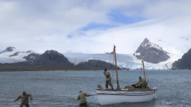 "In this July, 13, 2012 photo released by Shackleton Epic, expedition members pull their boat ashore on Elephant Island during their training. A modern-day team of six led by Tim Jarvis and Barry ""Baz"" Gray used similar equipment and clothes to re-enact a 1916 expedition led by Ernest Shackleton to save his crew after their ship got stuck in Antarctica's icy waters. They reached an old whaling station on remote South Georgia island Monday, Feb. 11, 2013, 19 days after leaving Elephant Island. Just as Shackleton did in 1916, Jarvis and his team sailed 800 nautical miles across the Southern Ocean in a small lifeboat and then climbed over crevasse-filled mountains in South Georgia. (AP Photo/Shackleton Epic, Jo Stewart)"