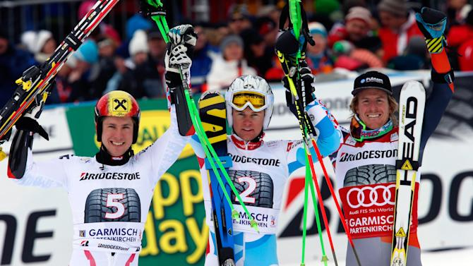 France's Alexis Pinturault, center, winner of an alpine ski, men's world cup giant slalom, celebrates at the finish area with second-placed Marcel Hirscher, of Austria, left, and third-placed Ted Ligety, of the United States, in Garmisch-Partenkirchen, Germany, Sunday, Feb. 24, 2013. (AP Photo/Alessandro Trovati)