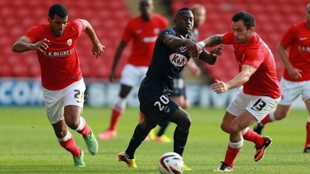 Bordeaux's Henri Saivet loses out to Barnsley's Chris Dagnall and Jacob Mellis during the pre-season friendly at Oakwell Stadium, Barnsley (PA Photos)