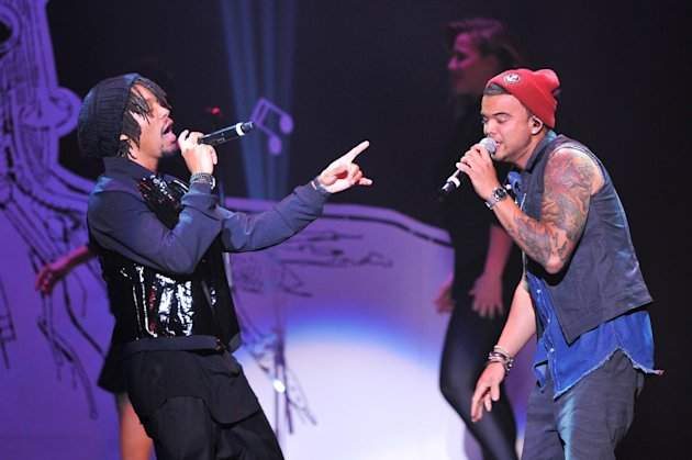 Singers Lupe Fiasco, left, and Guy Sebastian perform at &quot;Play It Forward: A Celebration of Music&#39;s Evolution and Influencers&quot; at the Grammy Foundation&#39;s 15th Annual Music Preservation Project, Thursday, Feb. 7, 2013, in Los Angeles. (Photo by Vince Bucci/Invision/AP)