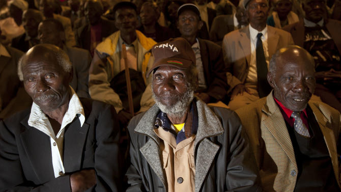 Mau-Mau veterans await a press conference about an announcement regarding their legal case for compensation against the British Government, in Nairobi, Kenya Thursday, June 6, 2013.  The British government is set to announce compensation for Kenyans abused during a rebellion against colonial rule in the 1950s. (AP Photo/Ben Curtis)