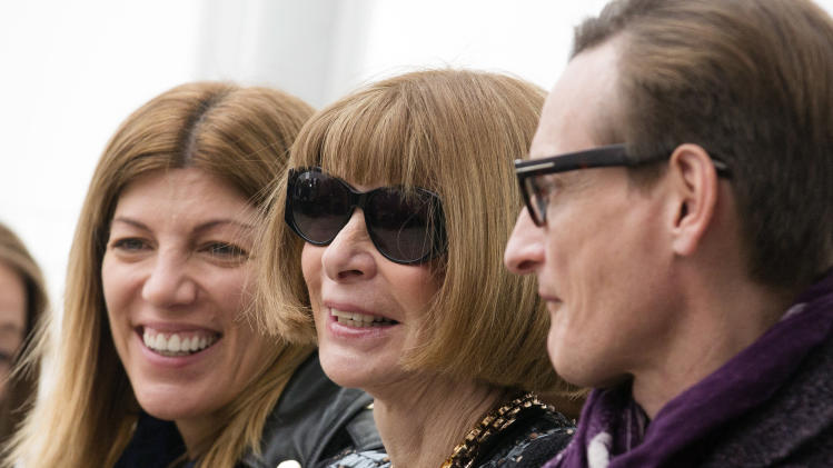 Vogue magazine editor-in-chief Anna Wintour, center, waits for the Derek Lam Fall 2013 fashion show to begin during Fashion Week, Sunday, Feb. 10, 2013, in New York. (AP Photo/John Minchillo)