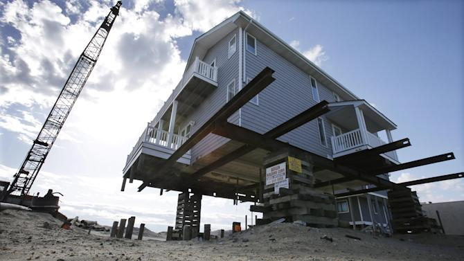 An oceanfront home is being raised to protect from flooding in Ortley Beach, N.J., Thursday, April 25, 2013. Six months after Suprestorm Sandy devastated the Jersey shore and New York City and pounded coastal areas of New England, the region is dealing with a slow and frustrating, yet often hopeful, recovery. (AP Photo/Mel Evans)