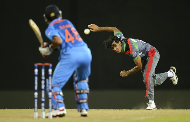 Afghanistan's Zadran bowls to India's Raina during their ICC World Twenty20 group A match in Colombo