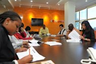 CCTV Africa journalists attend an editorial meeting in the organisation's office in Nairobi. The Chinese TV giant also has programmes in French, Spanish, Arabic and Russian, while the state news agency Xinhua is also expanding worldwide