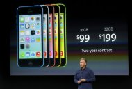 Phil Schiller, senior vice president of worldwide marketing for Apple Inc, talks about the pricing of the new iPhone 5C at Apple Inc's media event in Cupertino, California September 10, 2013. REUTERS/Stephen Lam
