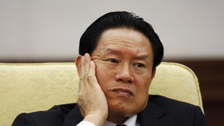 File photo of then China's Public Security Minister Zhou reacts as he attends the Hebei delegation discussion sessions at the 17th National Congress of the CPC in Beijing