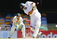 South African batsman Jacques Kallis drives Nathan Lyon of South Africa for six runs on day five of their first Test at the Gabba. South Africa staved off Australia's push for an unlikely victory to bat out for a draw in the first Test on Tuesday