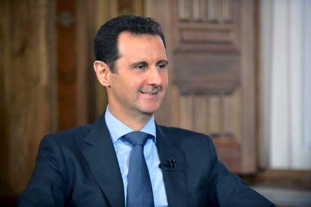 Syria's President Bashar al-Assad answers questions during an interview with al-Manar's journalist Amro Nassef, in Damascus