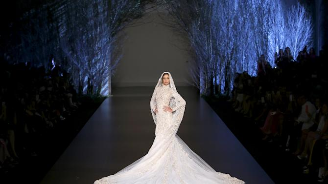 A model presents a wedding dress by Australian designers Tamara Ralph and Michael Russo as part of their Haute Couture Fall Winter 2015/2016 fashion show for British fashion house Ralph & Russo in Paris