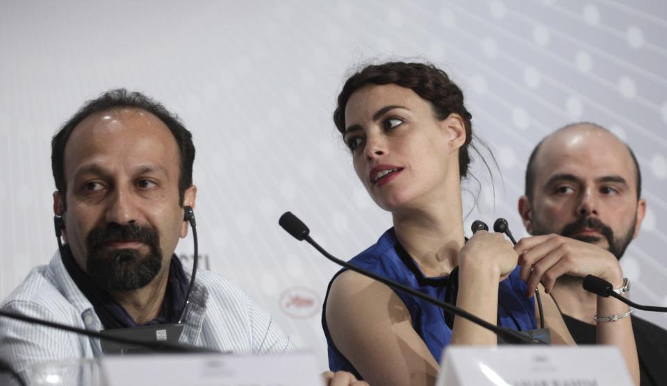 From left, directer Asghar Farhadi, actors Berenice Bejo and Ali Mosaffa listen to questions during a press conference for the film The Past at the 66th international film festival, in Cannes, southern France, Friday, May 17, 2013. (AP Photo/Virginia Mayo)