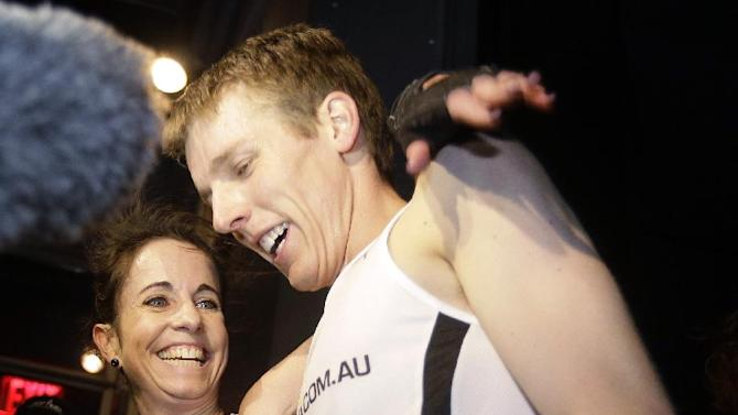 Suzy Walsham, right, and Mark Bourne, both of Australia, celebrate after their victories in the Empire State Building Run-Up, Wednesday, Feb. 6, 2013, in New York.  (AP Photo/Frank Franklin II)