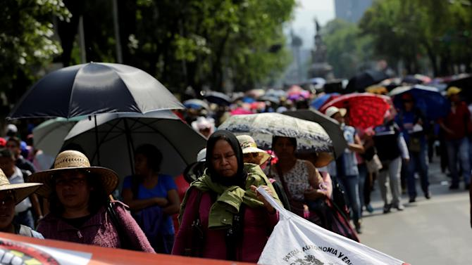 Protesters belonging to the National Coordination of Education Workers (CNTE) teachers' union and relatives of some of the 43 missing students of Ayotzinapa College Raul Isidro Burgos march, in Mexico City
