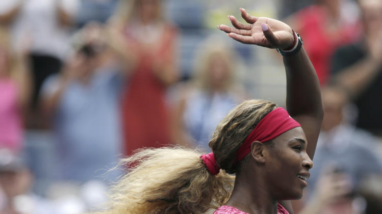 Serena Williams, of the United States, reacts after defeating Kaia Kanepi, of Estonia, during the fourth round of the 2014 U.S. Open tennis tournament, Monday, Sept. 1, 2014, in New York. (AP Photo/Charles Krupa)