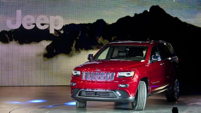 The 2014 Jeep Grand Cherokee is introduced at the North American International Auto Show, Monday, Jan. 14, 2013, in Detroit, Mich. (AP Photo/Tony Ding)