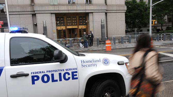 Security is set up outside Manhattan federal court, Tuesday, Oct. 9, 2012, in New York. Three accused international terrorists from Great Britain including Abu Hamza al-Masri will appear in court Tuesday. (AP Photo/ Louis Lanzano)