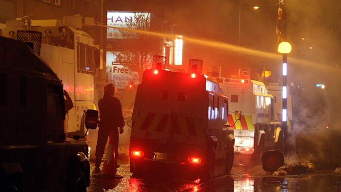 Police use water cannon to disperse rioting Loyalists on the Newtownards Road in Belfast, Monday, Jan. 7, 2013, a month after the City Council decided to fly the union flag on designated days only. Protesters have been out in force — with sometimes violent results — since a Dec. 3 decision by Belfast City Council to stop flying the British flag year-round. Such issues of symbolism frequently inflame sectarian passions in Northern Ireland, where Protestants mainly want to stay in the United Kingdom and Catholics want to unite with the Republic of Ireland. (AP Photo/PA, Paul Faith)  UNITED KINGDOM OUT  NO SALES  NO ARCHIVE  PRESS ASSOCIATION Photo. Picture date: Monday January 7, 2013. See PA story ULSTER Protests. Photo credit should read: Paul Faith/PA Wire