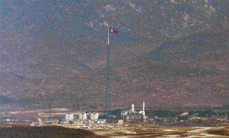A North Korean flag on a tower flutters in the wind at a North Korean village near the truce village of Panmunjom in the demilitarized zone separating the two Koreas in this picture taken just south o