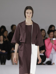 A model wears a creation part of the Jil Sander women's Spring-Summer 2013 collection that was presented in Milan, Italy, Saturday, Sept. 22, 2012. (AP Photo/Luca Bruno)