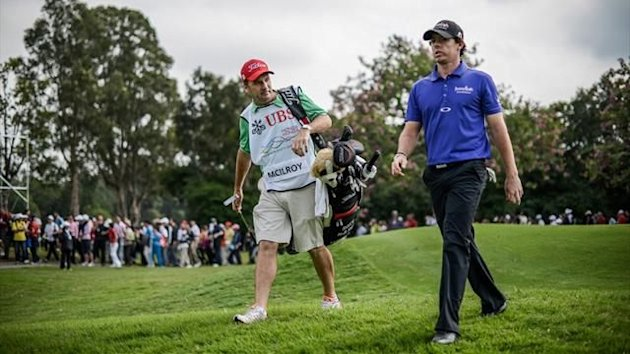 Rory McIlroy with his caddy during the second day of the UBS Hong Kong Open at the Hong Kong Golf Club (AFP)