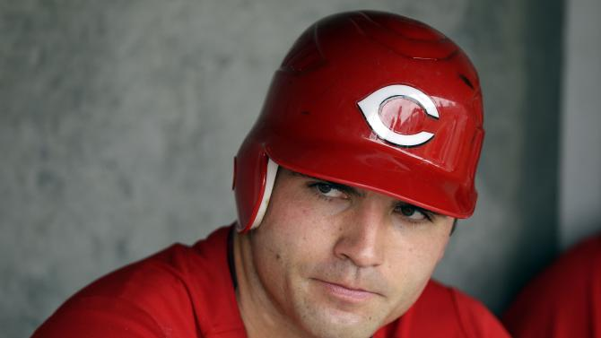 FILE - This March 25, 2012 file photo shows Cincinnati Reds' Joey Votto in the dougout during  a spring training baseball game, in Scottsdale, Ariz. The Reds are discussing a new contract with Votto that would extend beyond the 2013 season. (AP Photo/Marcio Jose Sanchez, FIle)