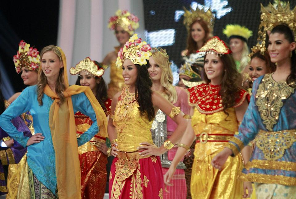 The 63rd Miss World Pageant contestants wear Indonesian's traditional dress during opening ceremony in Nusa Dua, Bali, Indonesia on Sunday, Sept. 8, 2013. (AP Photo/Firdia Lisnawati)