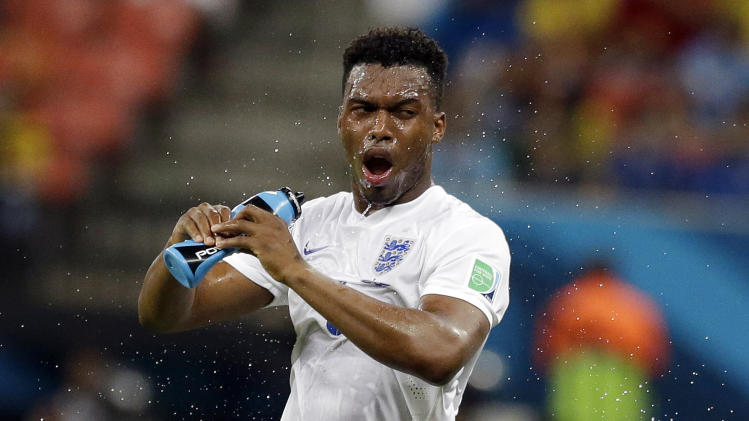 England's Daniel Sturridge douses himself down during the group D World Cup soccer match between England and Italy at the Arena da Amazonia in Manaus, Brazil, Saturday, June 14, 2014. (AP Photo/Matt Dunham)