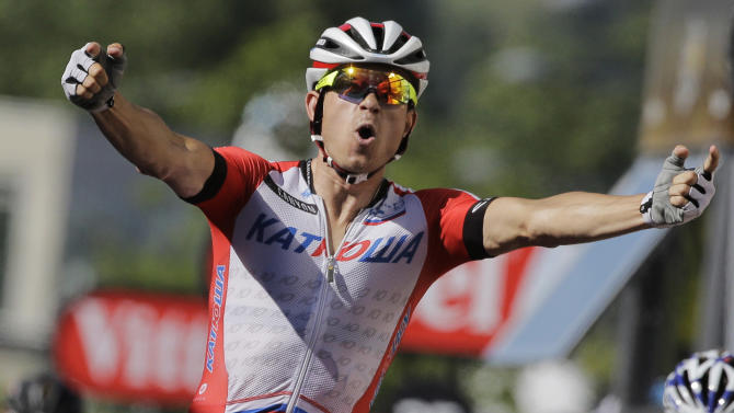 Norway's Alexander Kristoff crosses the finish line ahead of France's Arnaud Demare, bottom right, to win the twelfth stage of the Tour de France cycling race over 185.5 kilometers (115.3 miles) with start in Bourg-en-Bresse and finish in Saint-Etienne, France, Thursday, July 17, 2014. (AP Photo/Laurent Cipriani)