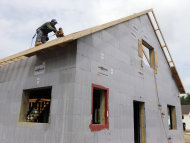 <p> FILE - In this July 9, 2013, file photo, a construction worker drills on the roof of a new home in New Paltz, N.Y. The Commerce Department reports on new-home sales for July, on Friday, Aug. 23, 2013. (AP Photo/Mike Groll, File)