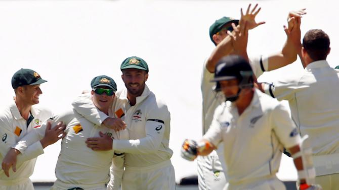 Australia's captain Smith celebrates with team-mates after taking a catch to dismiss New Zealand's Watling for seven runs during the third day of their third cricket test match at the Adelaide Oval, in South Australia