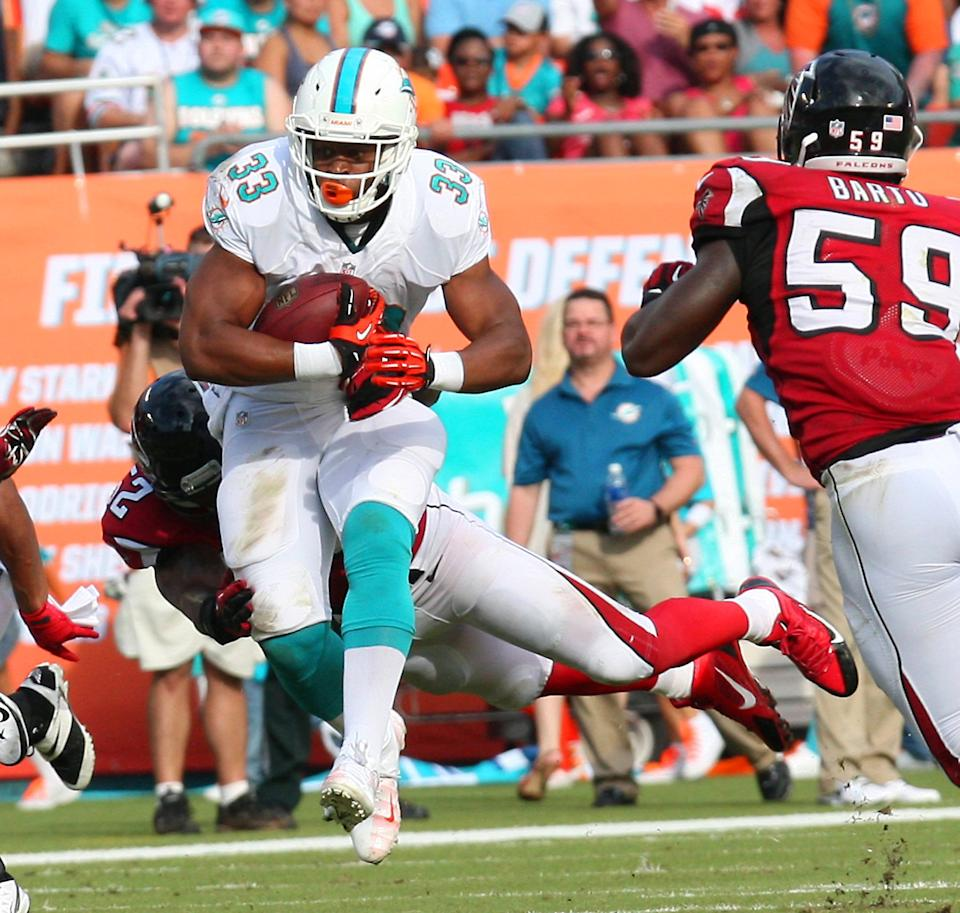 Dolphins get extra day to bask in 3-0 record