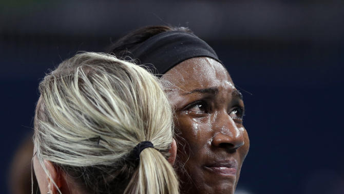 USA's Foluke Akinradewo, right, cries as she hugs teammate Jordan Larson after losing to Brazil 3-1 during a women's volleyball gold medal match at the 2012 Summer Olympics Saturday, Aug. 11, 2012, in London. (AP Photo/Chris O'Meara)