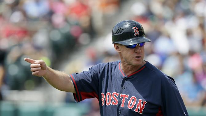 Boston Red Sox third base coach Brian Butterfield looks back to the dugout during the first inning of a spring training exhibition baseball game against the Atlanta Braves in Kissimmee, Fla., Friday, March 27, 2015. (AP Photo/Carlos Osorio)