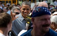 US President Barack Obama (C) greets people after speking during a campaign event at Wolcott House Museum Complex in Maumee, Ohio. Obama Thursday heralded his first re-election campaign bus tour with a new trade blast at China and fresh accusations his White House foe Mitt Romney helped send US jobs abroad