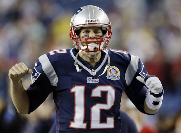 New England Patriots quarterback Tom Brady reacts as he runs onto the field before an NFL football game against the Houston Texans in Foxborough, Mass., Monday, Dec. 10, 2012. (AP Photo/Elise Amendola