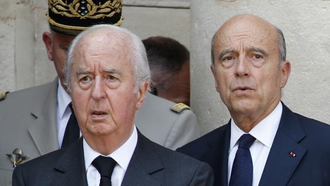 Former French Prime Ministers Edouard Balladur and Alain Juppe attend the funeral of late former French right-wing politician Charles Pasqua at the Invalides in Paris
