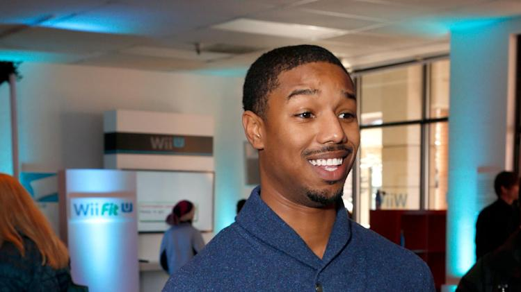 IMAGE DISTRIBUTED FOR NINTENDO - Actor Michael B. Jordan warms up and checks out Wii U at the Nintendo Lounge during a break from the Sundance Film Festival on Monday, Jan. 21, 2013 in Park City, Utah. (Photo by Todd Williamson/Invision for Nintendo/AP Images)