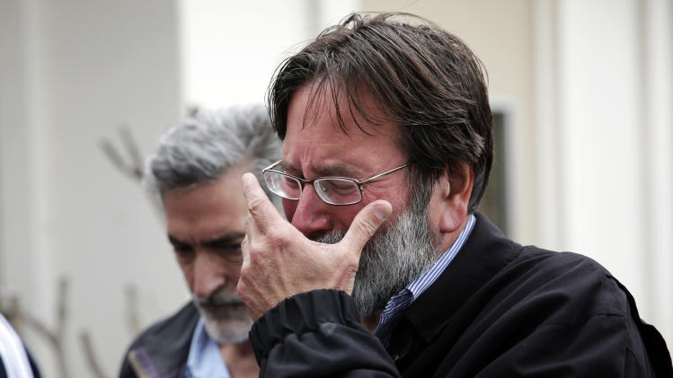 Richard Martinez who says his son Christopher Michael-Martinez was killed in Friday night's mass shooting that took place in Isla Vista, Calif., breaks down as he talks to media outside the Santa Barbara County Sheriff's Headquarters on Saturday, May 24, 2014, in Santa Barbara, Calif. (AP Photo/Jae C. Hong)