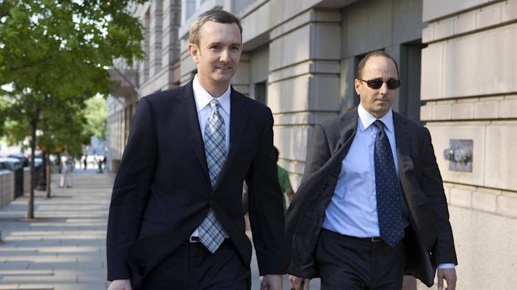Attorney Christopher Duffy, left, walks with New York Yankees General Manager Brian Cashman, as they leave federal court from the trial of Roger Clemens in Washington, Thursday, May 10, 2012. Clemens is on trial for allegedly lying to Congress in 2008. (AP Photo/Jacquelyn Martin)