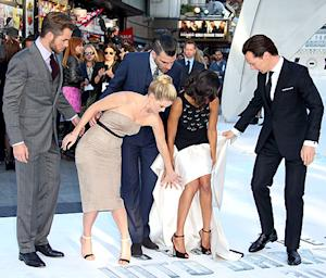 Zoe Saldana Nearly Trips on Her Dress at Star Trek Into Darkness Premiere