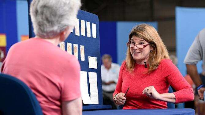"This Aug. 9, 2014 photo released by Antiques Roadshow shows Leila Dunbar appraising a collection of early Boston baseball memorabilia for the program ""Antiques Roadshow"" in New York. This is the largest sports memorabilia find in the program's 19-year history, valued at $1 million. (AP Photo/Leila Dunbar, Meredith Nierman)"