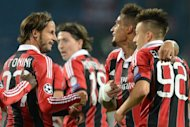 Kevin-Prince Boateng (2nd R), Luca Antonini (L) and Stephan El Shaarawy (R) of AC Milan celebrate after scoring a goal against FC Zenit St Petersburg during their UEFA Champions League group C match in Saint-Petersburg on October 3. AC Milan won 3-2