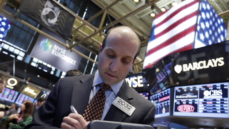 Stocks edge lower as investors wait on Fed