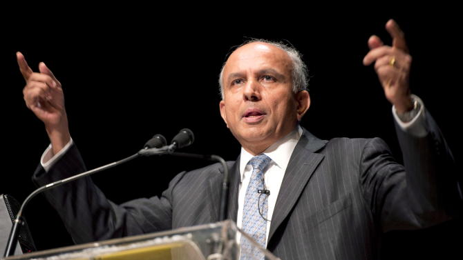 In this April 11, 2013 photo Fairfax Financial Chairman and CEO Prem Watsa speaks at the company's annual general meeting in Toronto. Watsa on Wednesday, Sept. 25, 2013 said he has every intention of completing the acquisition of BlackBerry, despite doubts that the $4.7 billion deal for the troubled smartphone maker will go through. (AP Photo/The Canadian Press, Frank Gunn)